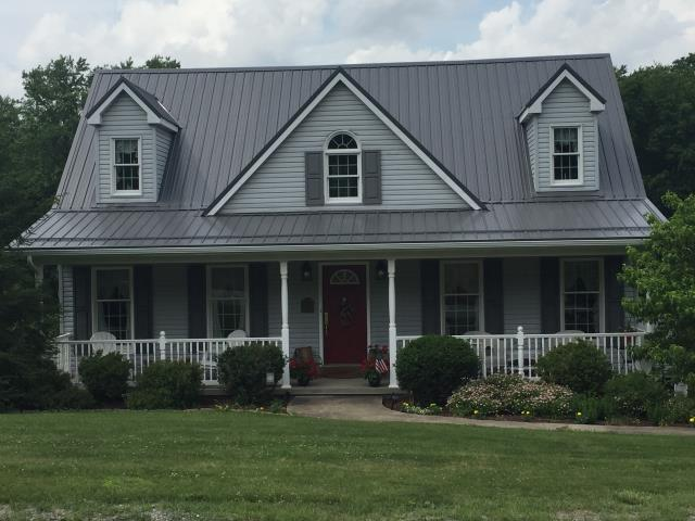 Midway, PA - Take a look at this story book home with a gorgeous Charcoal metal roof, just imagine how beautiful your home will look with a new metal roof.