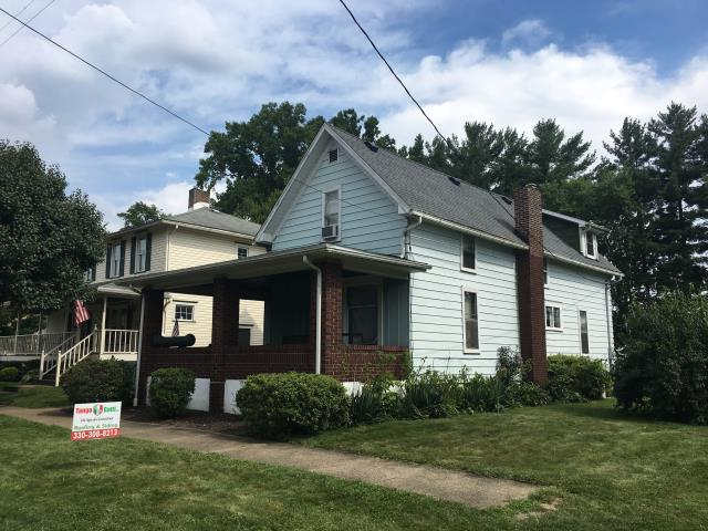 Uhrichsville, OH - Take a look at this charming two-story with GAF Timberline HD Osyter Grey shingles