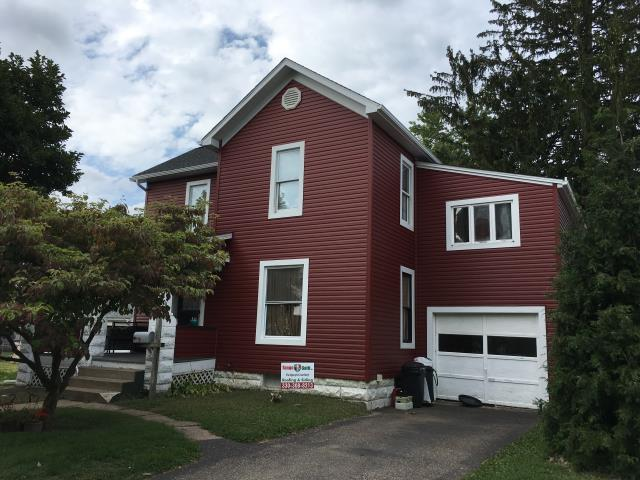 New Philadelphia, OH - Take a look at this beautiful, transformed home. New vinyl siding - mountain berry and new GAF timberlne charcoal shingles.