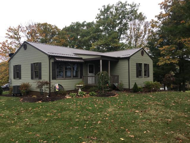 Bulger, PA - What a charming  home  with new Heart Tech sage siding and a Premier bronze metal  roof