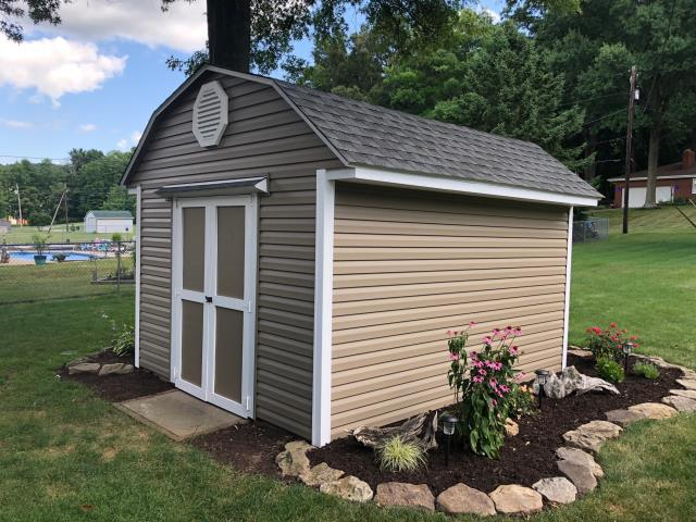 Dover, OH - The client used Heart-Tech Dutch Lap Canyon color siding, added the Octagon louver and white trim and turned this little shed into a beautiful storage barn!