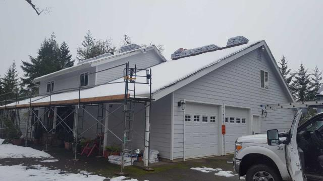 Roseburg, OR - Have to do a little snow removal before we can install a GAF Grand Sequoia asphalt shingle near Roseburg.
