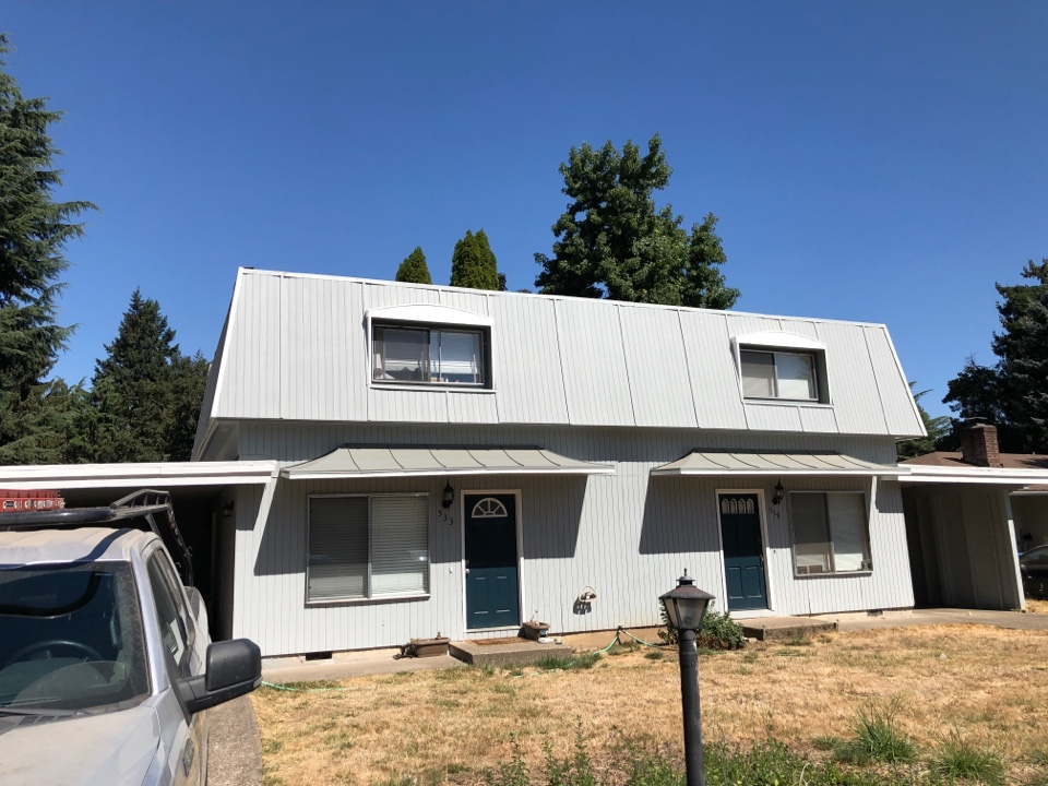 Eugene, OR - Bidding to replace all the cap metal on a flat roof.