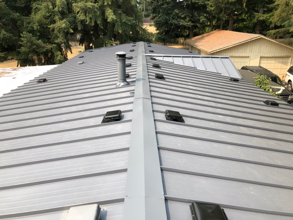 Eugene, OR - Just finished another Beautiful Taylor metal Versa span standing seam metal roof. When the paint is in we will come back to paint all the box vents.