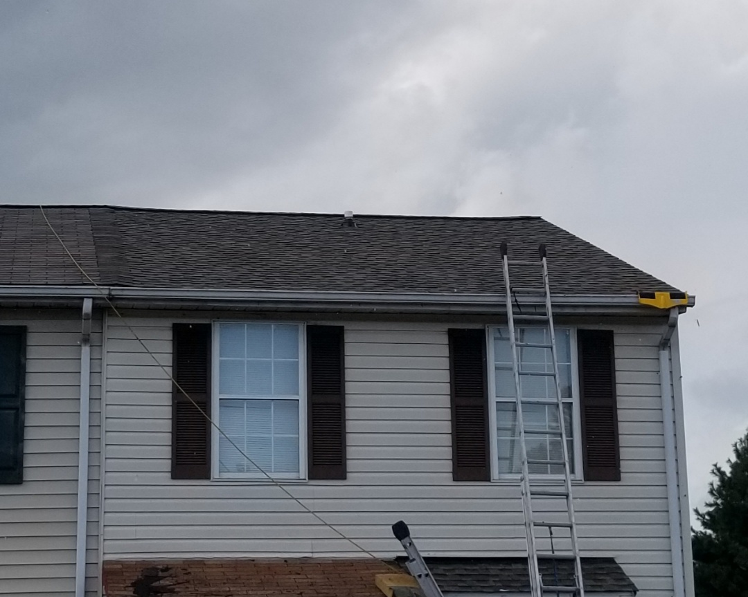 Essex, MD - Roof replacement installation with Timberline HDZ shingles in color Weathered Wood and Cobra Snow country ridge vent.
