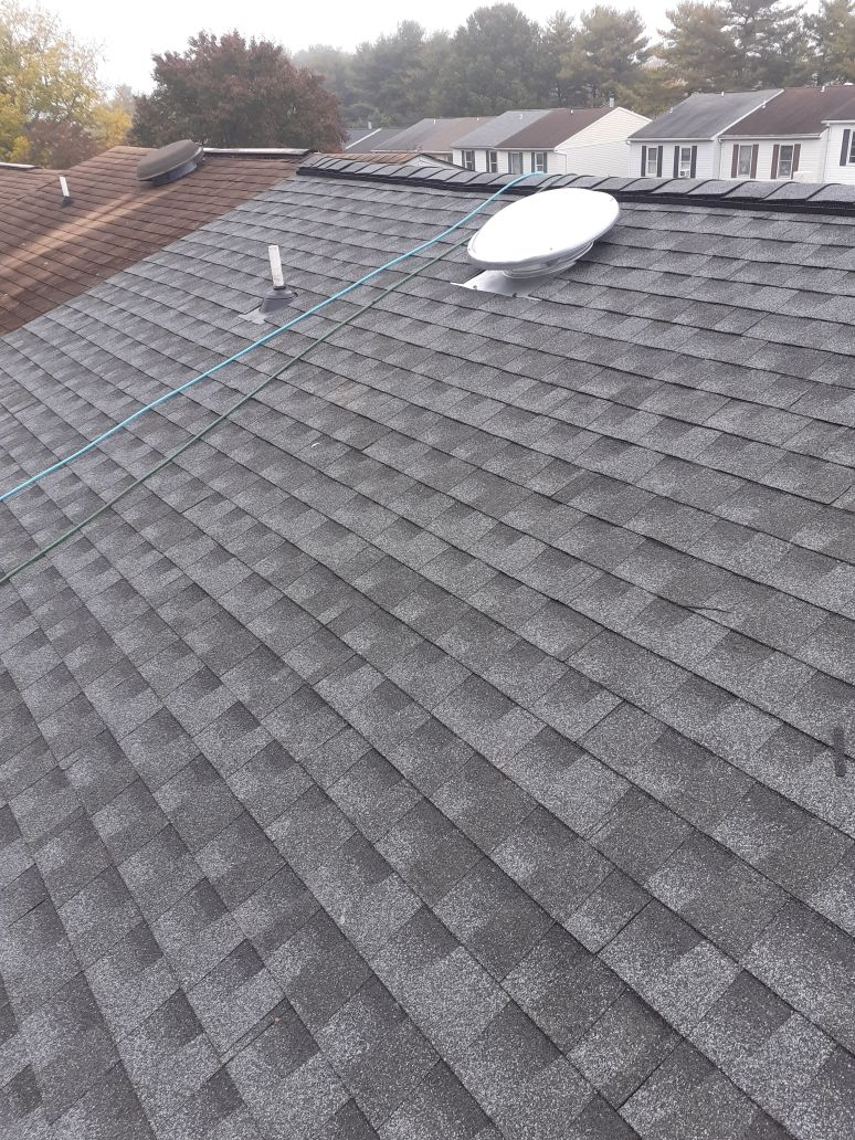 Parkville, MD - New roof installation completed. All GAF products, including GAF Timberline HDZ shingles in Pewter Gray color and Cobra Snow Country Advanced Ridge Vent.