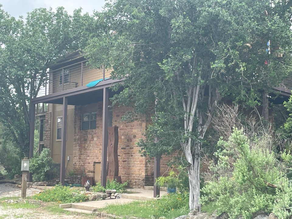 Horseshoe Bay, TX - Residential deck installation.  Metal-structural, metal hand rails, metal catwalk, composite deck boards.