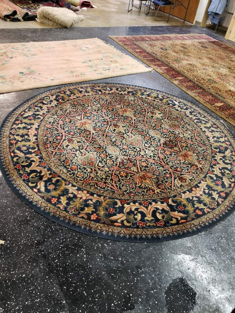 Round area rug with delicate flower design from the North side of Chicago. Cleaned and treated by Jerry.