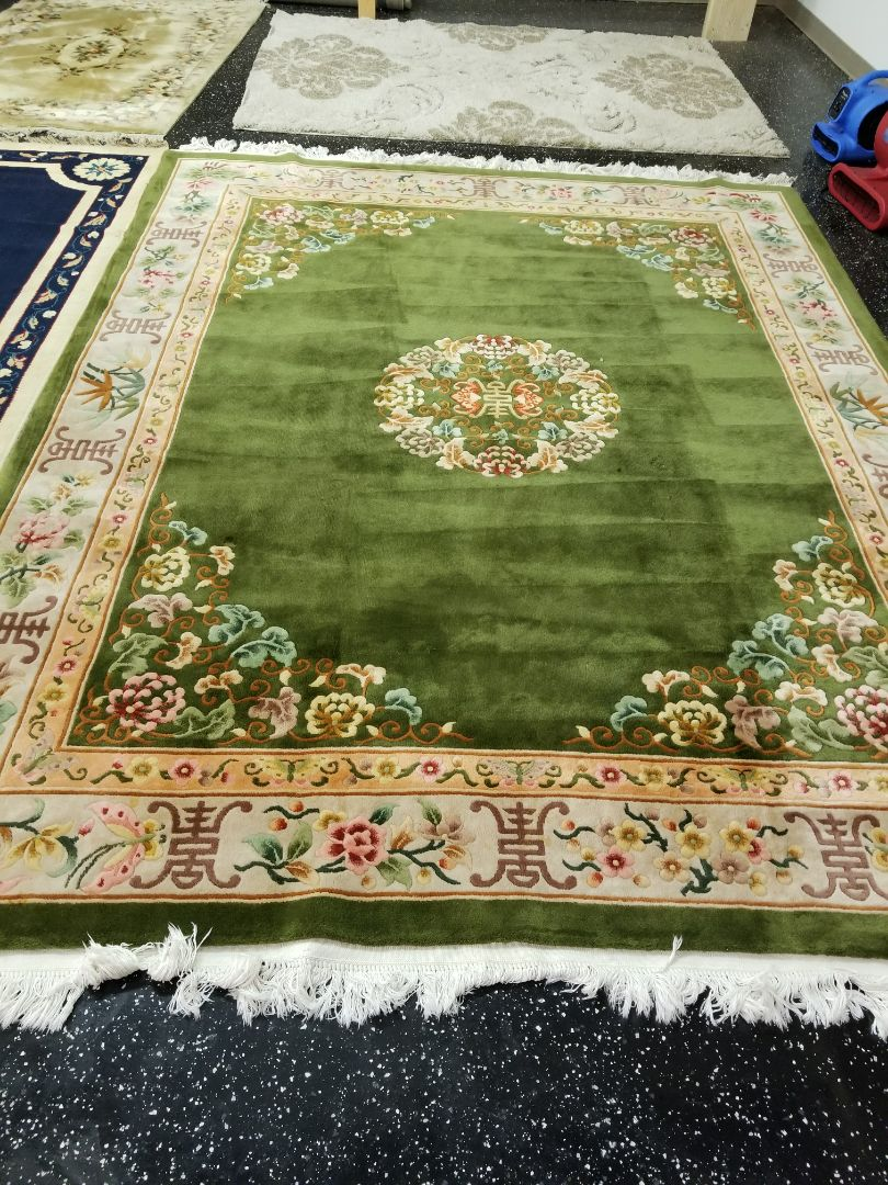 Vivid green wool rug, in need of a reboot, picked up from the Plainfield area. It was treated and serviced by Nick.