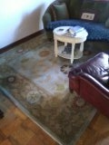 1 wool area rugs repaired and cleaned.
