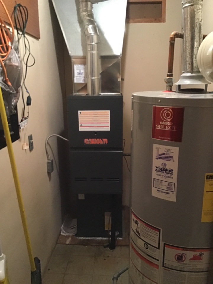 Installed new Tiger Signature Series gas furnace and air conditioner with static filter and digital thermostat.