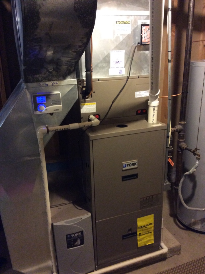 Marine, IL - Heating and cooling service call. Performing scheduled maintenance on a 2007 York furnace for a valued club members.