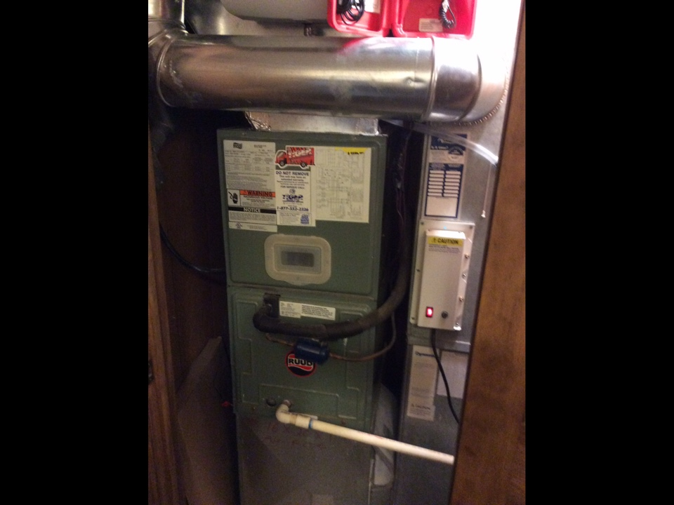 New Douglas, IL - Heating and cooling service call. Performing a safety inspection and cleaning a Rudd electric furnace with an Aprilaire Humidifier and UV air purification system.