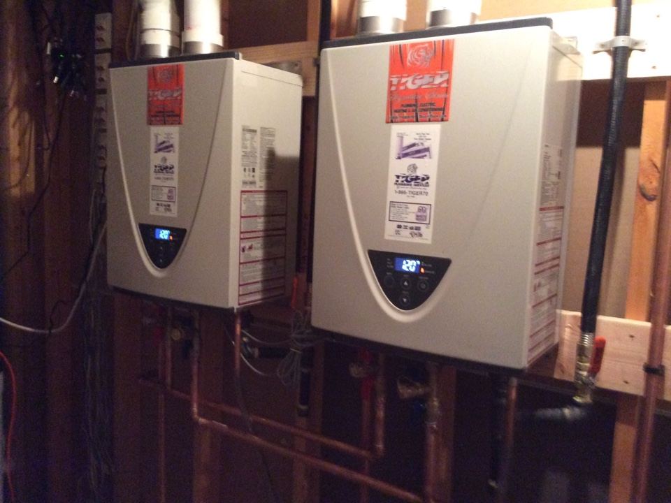 Moro, IL - Plumber needed for a plumbing service call. Installing two new Tiger Signature Series Tankless water heaters for optimal water heating throughout the home.