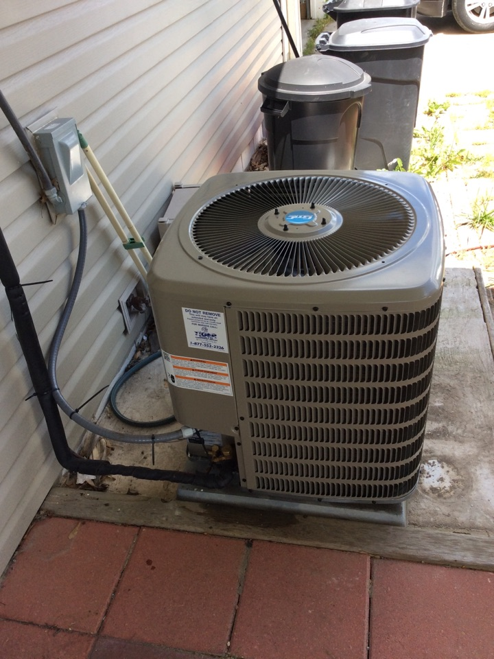Staunton, IL - Heating and air conditioning service call. Installing a new AC.