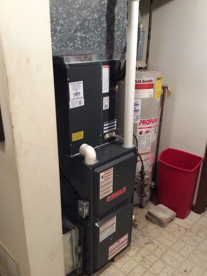 Dow, IL - Heating and air conditioning service call. Installing a new Tiger Signature Series LP gas furnace with matching AC and digital thermostat.