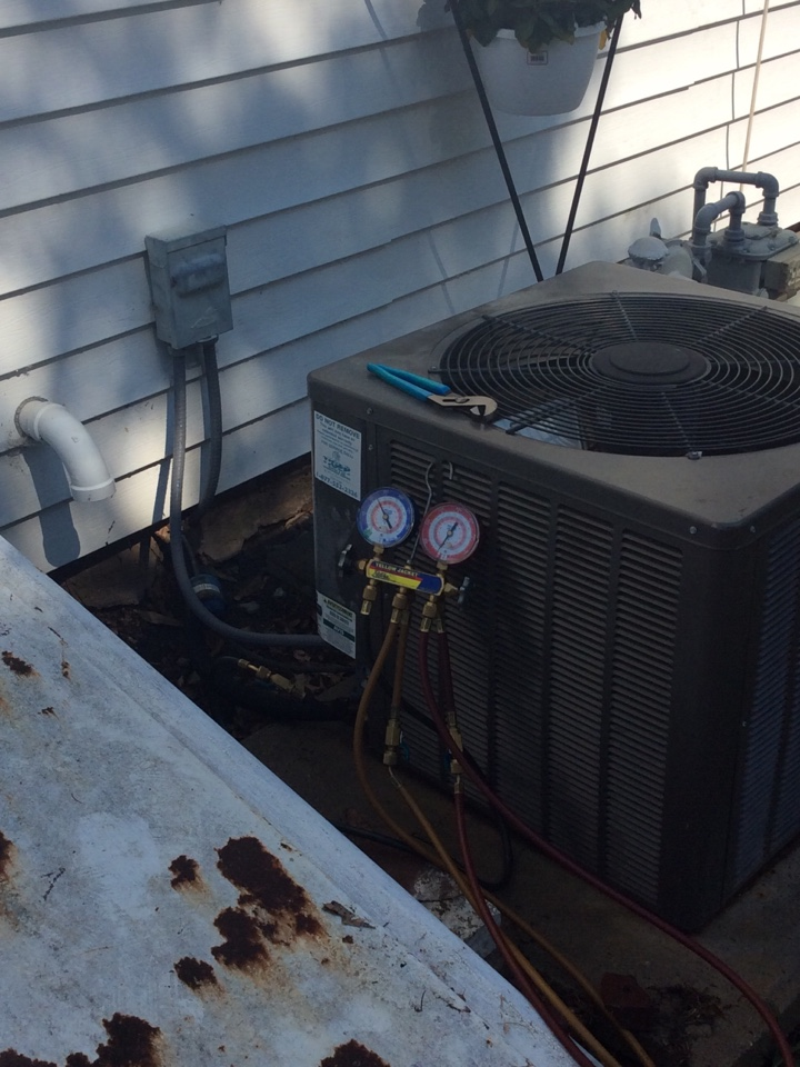 New Baden, IL - Heating and air conditioning service call. Performing an annual AC safety inspection for a valued club member.