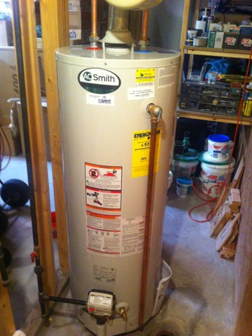 Marine, IL - Plumbing service call. Installed A O Smith 50 gallon LP water heater up to code.