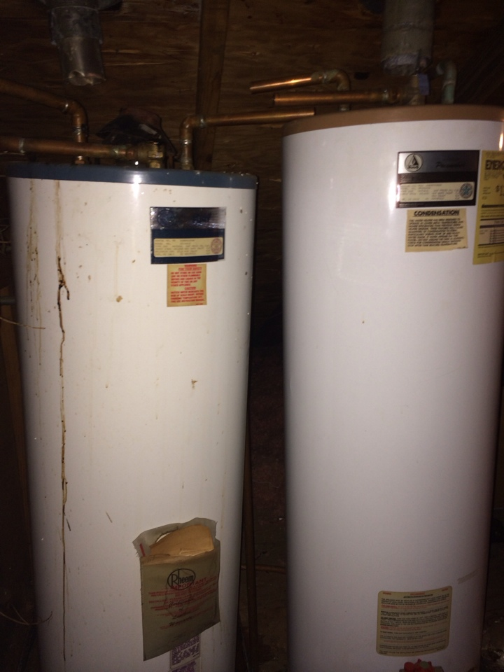 Montgomery, AL - Taking out two water heaters from the 80's and putting in one new water heater.
