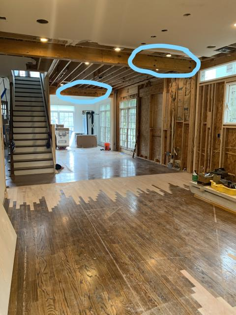 Birmingham, AL - The main wall between kitchen, living room and dining have been removed and beams installed to support the load above. The stairwell has also been opened up to allow for a more modern and open look soon to be complete with cable railing.