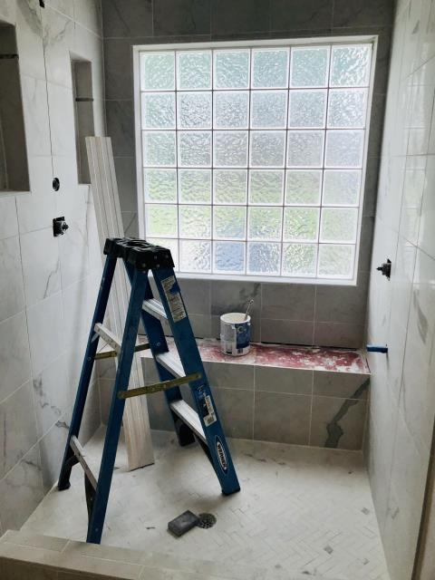 Birmingham, AL - We are seeing more and more clients request larger showers over their unused jetted tub. That is exactly what these customers wanted. We kept the glass block window which brings in so much natural light. This large shower will be equipped with multiple heads to include a rain head and handheld shower.