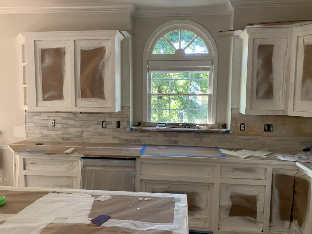 Hoover, AL - After adding additional cabinetry to the kitchen island and removing the desk area to create a coffee bar, a fresh coat of Benjamin Moore White Dove has been applied over all the oak cabinets. It is always amazing how a coat of paint makes such a difference to any room!