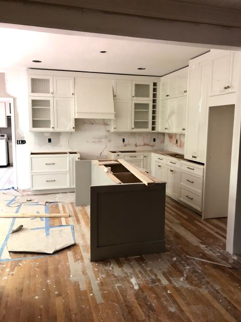 Vestavia Hills, AL - After opening up a wall between kitchen and dining, it allowed the kitchen to be reoriented in a new layout with island. By keeping the cabinetry light in color  and taking it to the ceiling it makes the room feel much larger.