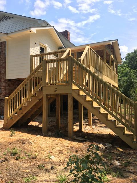 Vestavia Hills, AL - The new addition has been framed, siding is complete as well as the new deck and screened porch. We wanted to call out the dual stair cases for this new deck. The homeowners requested a staircase that could be accessed from either the patio side or the yard side. This allows ease of use no matter what part of the backyard you might be in or needing to get to.