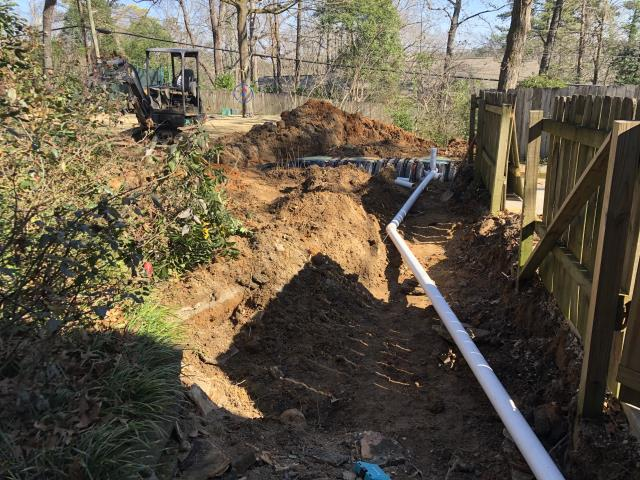 Birmingham, AL - It's a dirty job but someone has to do it. Installing a new and larger septic tank on a job that will recieve a two-story addition off the back of the house which will include a master bed, bath and a bonus room with bath.