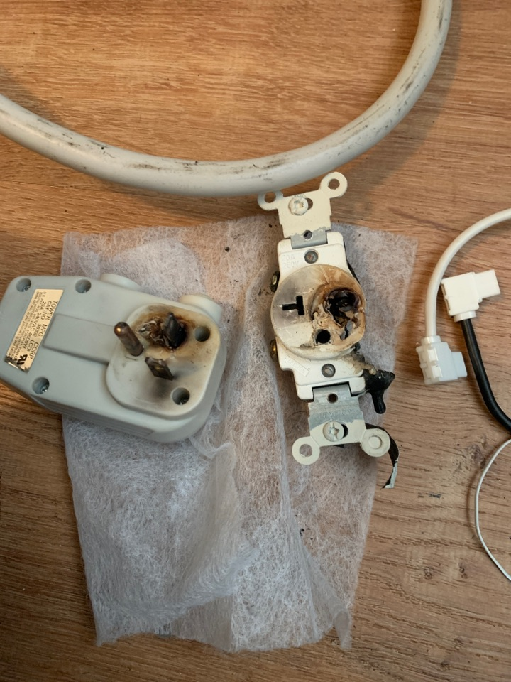 Replacing a plug and outlet for a through the wall air conditioner.