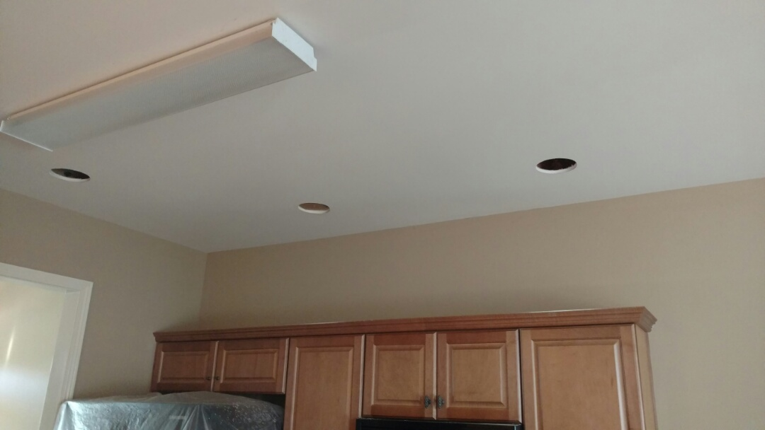 Helena, AL - Installing recess lights.  New home, the customer wants additional lighting in the kitchen and dining area.