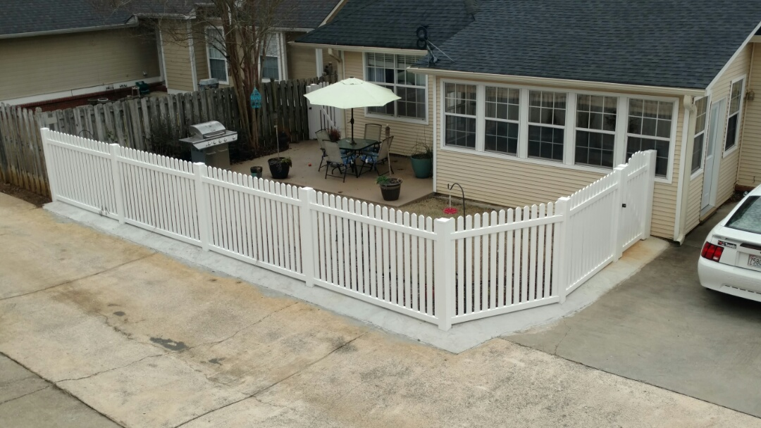 Pelham, AL - Replaced old deck & fence. Laid new concrete pad and vinyl fence.