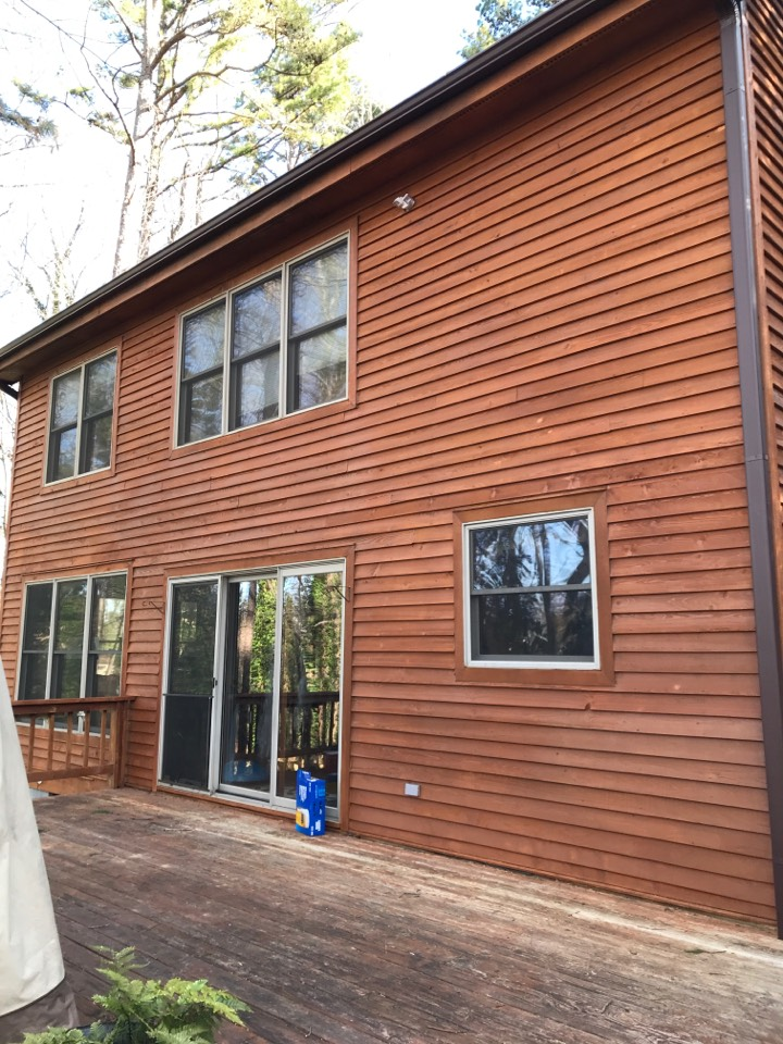 Raleigh, NC - New roof new gutters new stain on cedar siding. Cedar siding repairs.