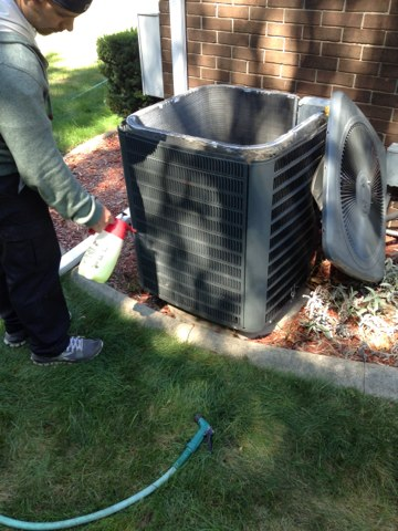 Chelsea, MI - Clean of the air conditioner changing filter