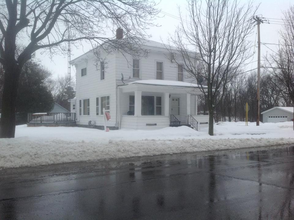 Leslie, MI - Another two story rental duplex free bid on wall furnace