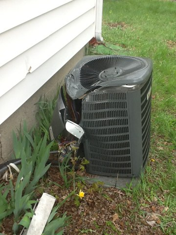 Stockbridge, MI - Air conditioner damaged from storm