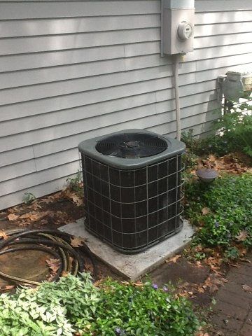 Horton, MI - Cleaning a outside condenser .