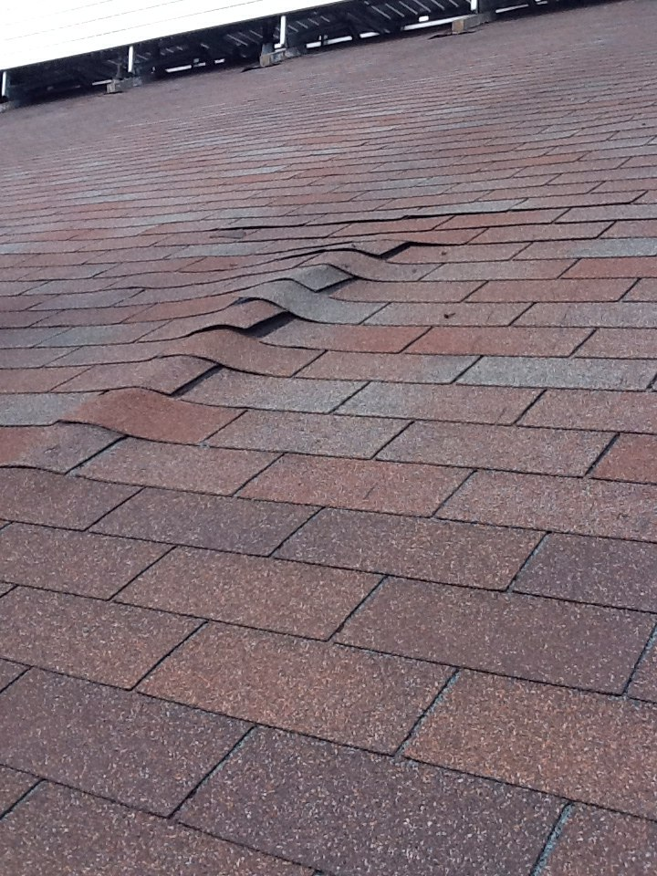 Columbus, OH - Hump in roof deck before repair Muth&Company Roofing.