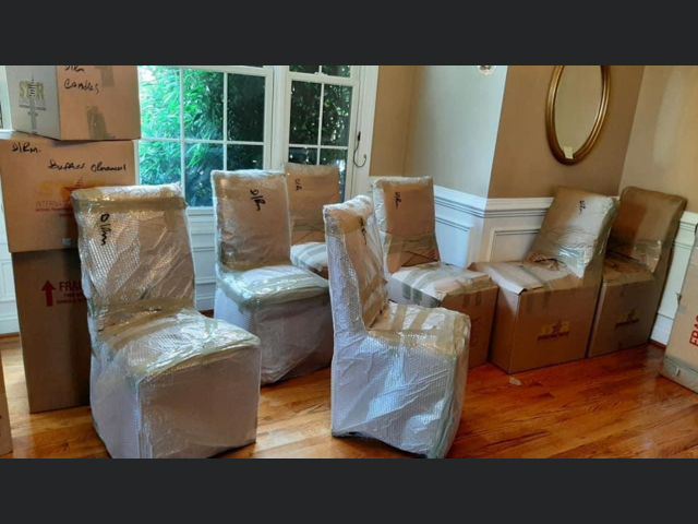 Arlington, VA - Protecting antique dining room chairs for a local move .