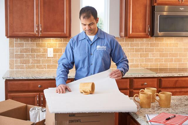 Washington, DC - Packing fragile dishes. Local packing and moving services