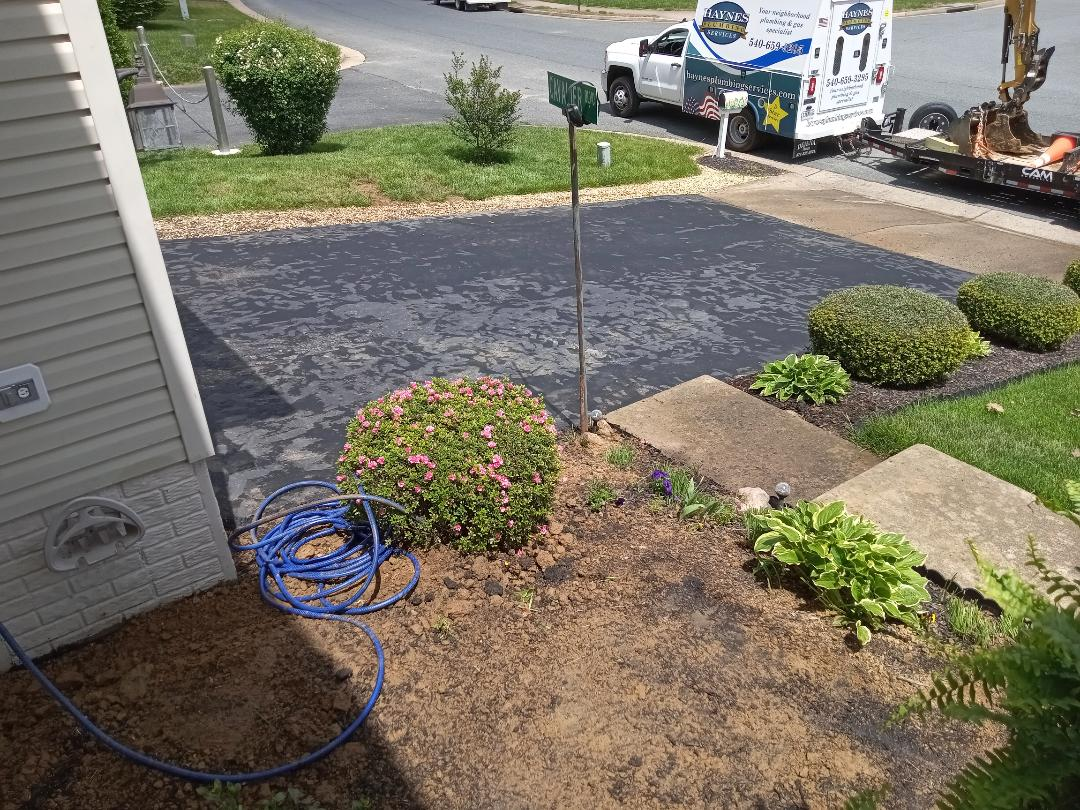 Installed New Water Main  from meter into front wall of  House moled under driveway from meter to house Installed new shutoff valve and pressure reduction valve on main inside