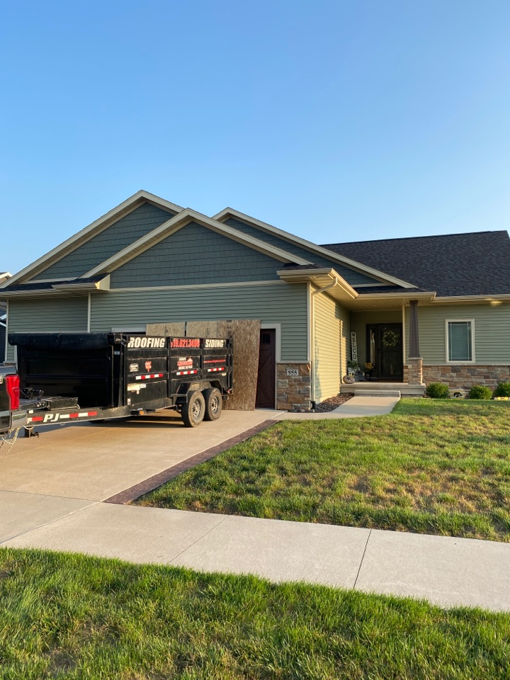 North Liberty, IA - Roof tear off and shingle in North Liberty. Roof has hail damage.