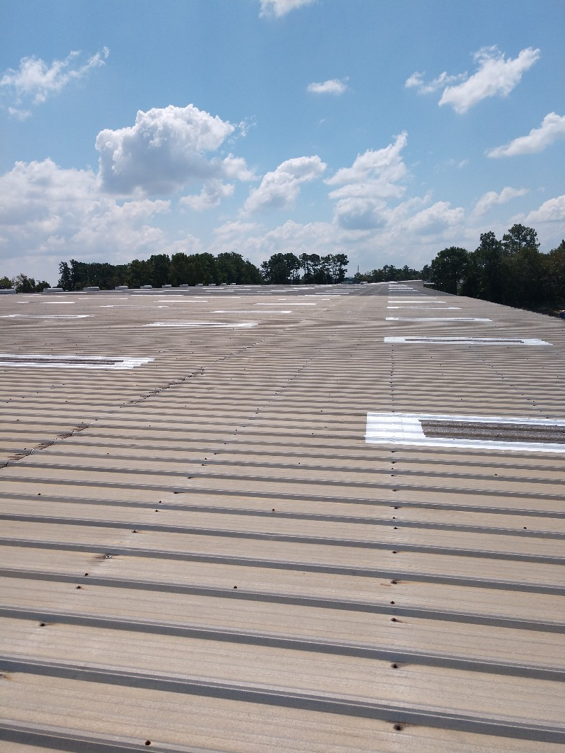 Hanahan, SC - Commercial repairs to a 65000 square-foot trucking facility. Extending the life of 482 skylights making them leak-free sealing lenses.