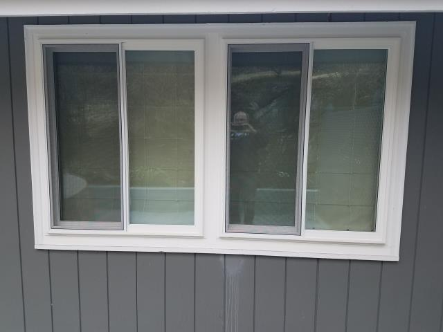 Greenwich, CT - Replaced original, worn out new construction window with Andersen 400 gliders.
