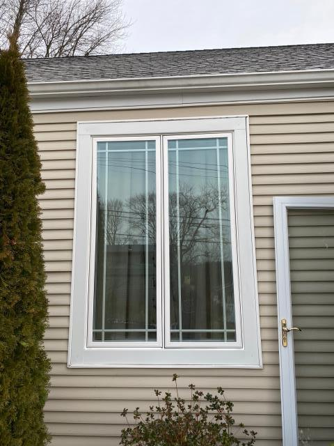 Bronxville, NY - Double Casement Window w/ Grilles Looks Great From the Outside Too!