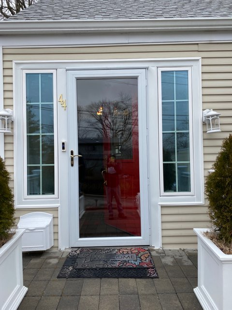 Yonkers, NY - One of our installers admiring his own work with this impromptu self portrait, his reflection courtesy of newly installed Marvin Windows and Door.