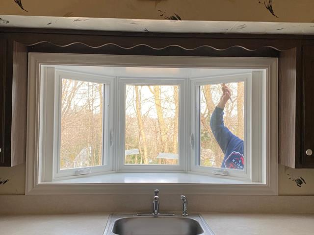 Ardsley, NY - Windows by Toll team putting the finishing touches on a Marvin Garden Bay Window. This really is a beautiful addition to the kitchen.