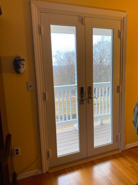 Yorktown, NY - Excellent job Windows By Toll! Marvin French Doors w/o Grilles stand out from in interior And the exterior.