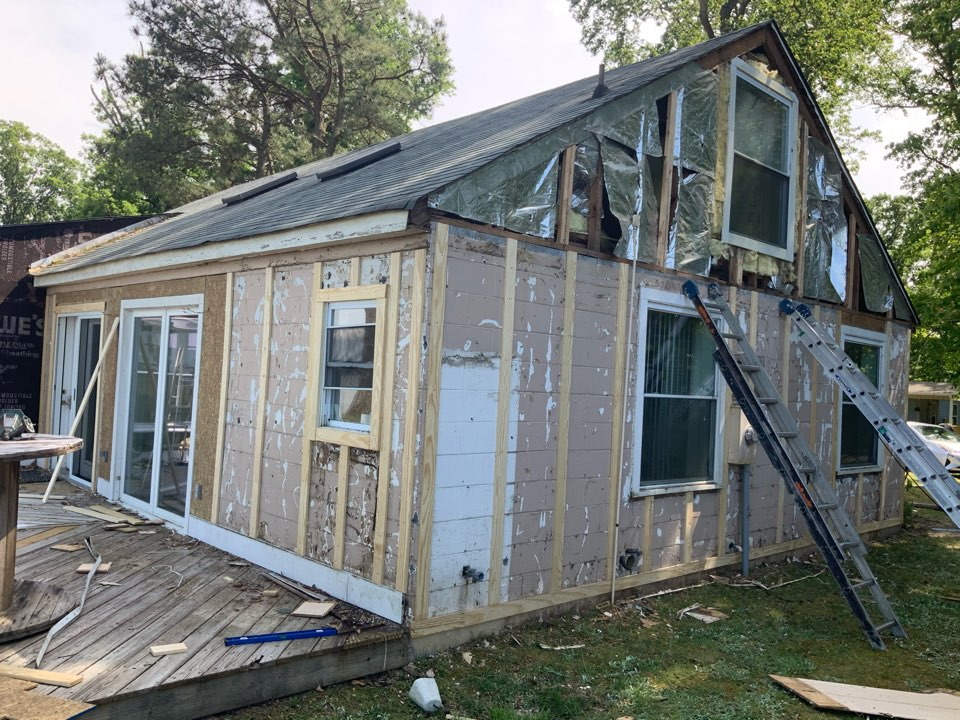 Spring Grove, VA - Removing old siding and installing furring strips onto cinderblock home in preparation for new siding install