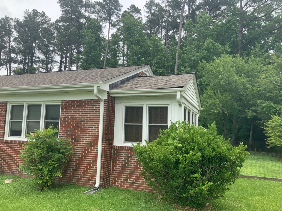 Suffolk, VA - Evaluating a roof repair where shingles have lifted up on the corner